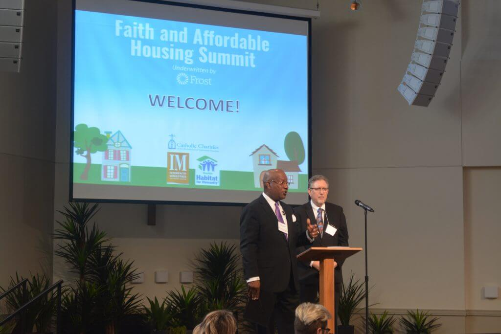 Rev. Harvey Clemons Jr. of Pleasant Hill Baptist Church and Steve Mikelman, Director of Housing and Economic Opportunities for Catholic Charities, address an audience of more than 100 faith and community leaders at the first-ever Faith and Affordable Housing Summit.