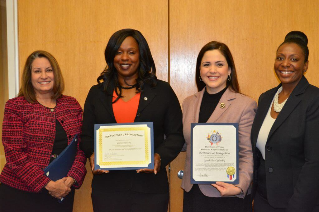 Yashika Olgesby (second from left) graduated from the Lotus Project program through Catholic Charities' Women Veteran Services.