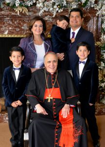 Event chairs Michelle and Stephen Fraga snap a photo with His Eminence Daniel Cardinal DiNardo at A Cardinal's Christmas. Pictured with their three children: Stephen Jr., Gregory and Andrew.