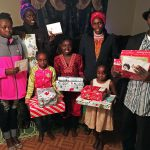 Esperance and her family received Christmas presents through Catholic Charities' Share Your Blessings program.