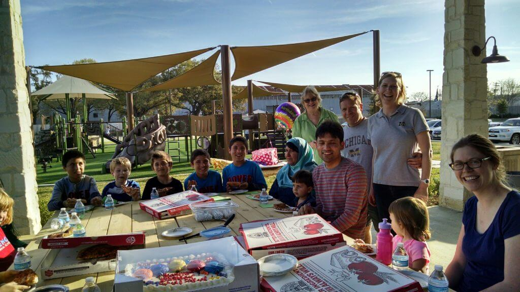 Since birthdays are not normally celebrated in Afghanistan, the Griffins threw an American-style birthday party for the Noor family's 13-year-old twin boys at a park playground, complete with pizza, cake and presents.