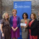 Frost Bank presents Catholic Charities with $10,000 for disaster relief.