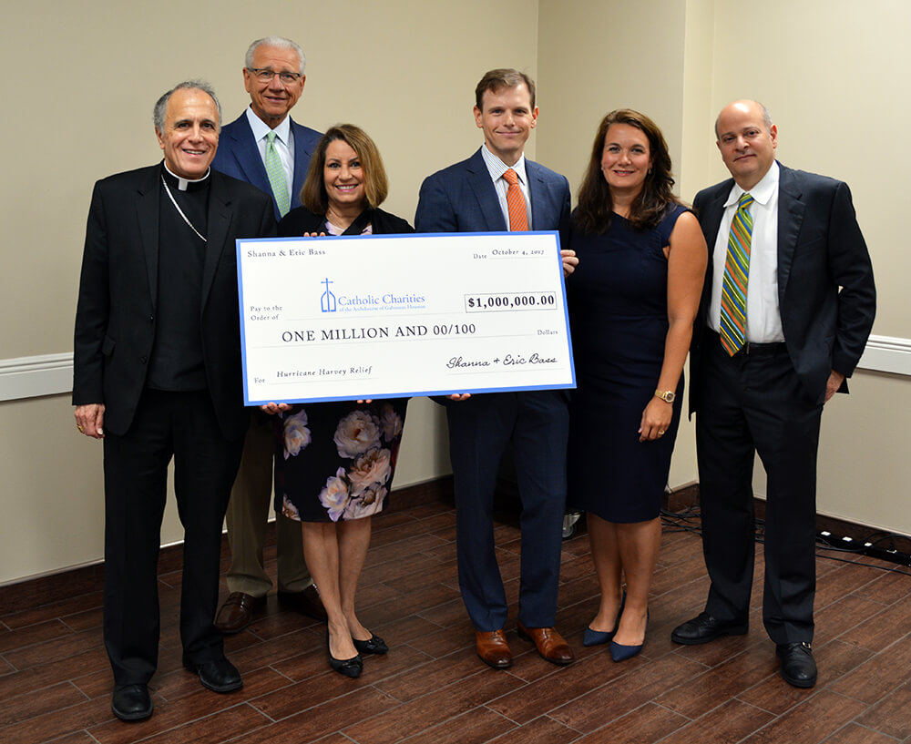 Eric and Shanna Bass donate $1 million to Catholic Charities for Harvey relief.