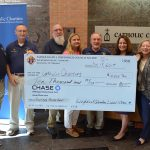 Knights of Columbus present a check to Catholic Charities for disaster relief.