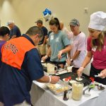 National Charity League - Azalea Chapter at Catholic Charities' Annual Mamie George Community Center Pancake Festival