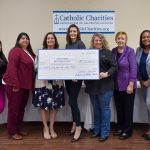 Catholic Charities presented a check to United Way Brazoria County and Brazoria County Long Term Recovery Committee.