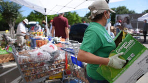 A volunteer helps at Catholic Charities' Mamie George Community Center food distribution.